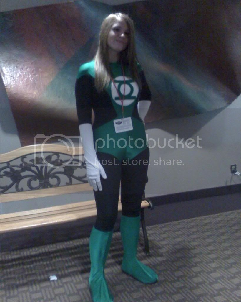 A girl poses as a Green Lantern -- the Green Lantern Corps are the galactic green police.